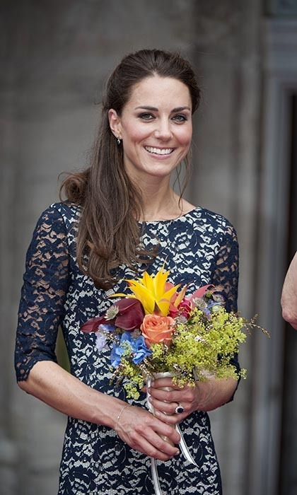For an official welcoming ceremony in Ottawa in 2011, Kate looked beautiful in a blue lace dress while holding an exotic floral arrangement.