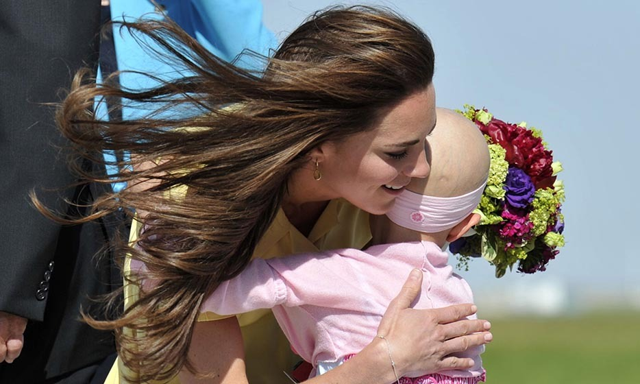 The Duchess received flowers and a big hug from six-year-old Diamond Marshall upon her arrival in Calgary with Prince William in 2011. The Make-a-Wish Foundation arranged for Diamond, a cancer patient, to greet the royal couple.