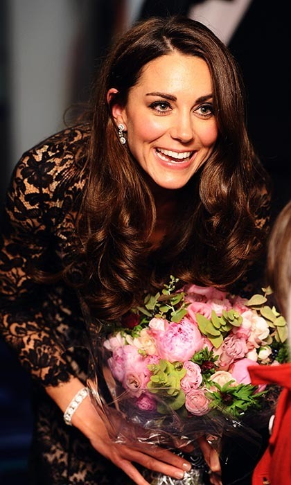 Kate was visibly delighted after she was presented with a bunch of flowers at the premiere of 'War Horse' in London.