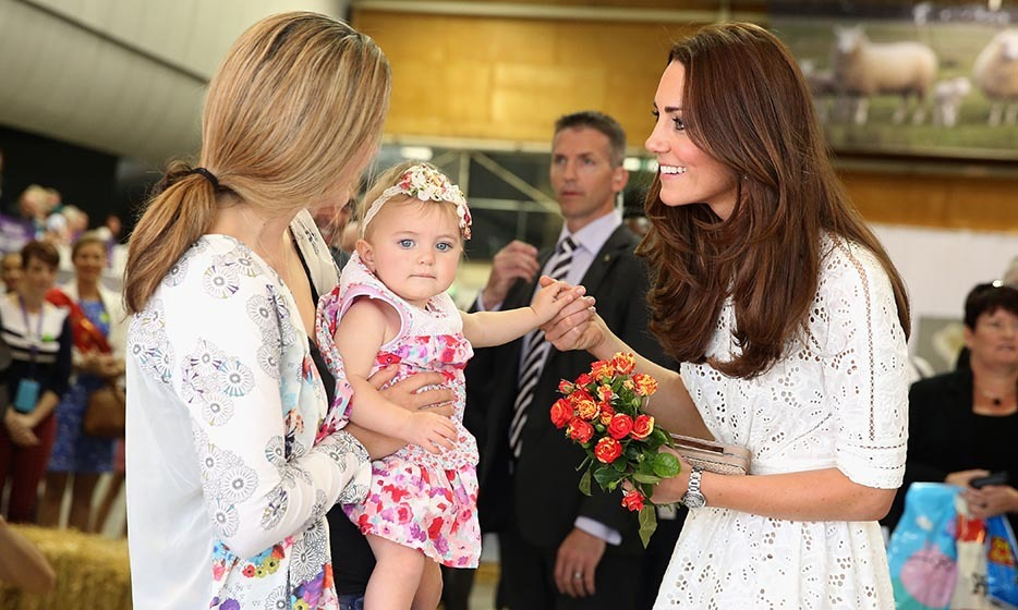 A young admirer presented Kate with a beautiful orange bouquet while on a visit to the Sydney Royal Easter Show on April 18, 2014.