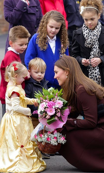 Catherine was charmed by a little girl dressed as a princess, who gave the Duchess a bouquet of pink flowers.