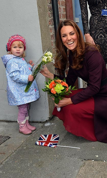 Two-year-old Lola Mackay refused to let go of the flowers she was due to give to Catherine during an official visit, which caused the princess to giggle with glee.