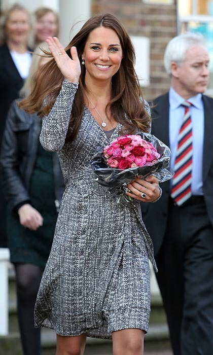 Newly pregnant Kate famously visited a women's treatment centre on Feb 18, 2013, where not even a colourful bouquet could distract from her tiny baby bump!
