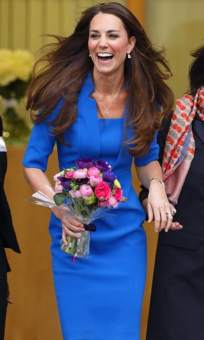 Kate was all smiles as she left Northolt High School holding a gorgeous bouquet of pink and indigo blooms on Valentine's Day.