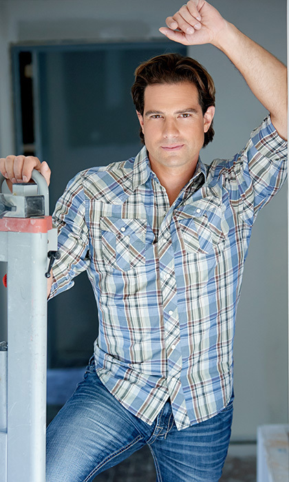 "SCOTT MCGILLIVRAY, 36: The handsome building contractor from Toronto is right at home as the host of 'Income Property.' ""My proudest personal moment was becoming a dad – a double whammy because it's happened twice,"" he says. Photo: © HGTV"