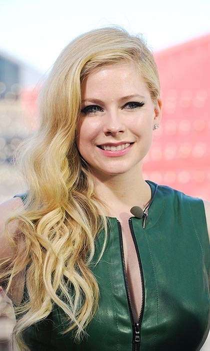 AVRIL LAVIGNE, 29: The former tomboy from Napanee, Ont. is now one of the world's biggest superstars. She famously married a fellow Canadian rockstar, Nickelback's Chad Kroeger, last summer — on Canada Day, no less! Photo: © Getty