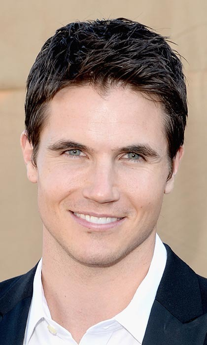 "ROBBIE AMELL, 26: The 'Tomorrow People' actor from Toronto loves ""staying in and taking it easy with my girlfriend,"" fellow Canadian actress Italia Ricci. Photo: © Getty Images"