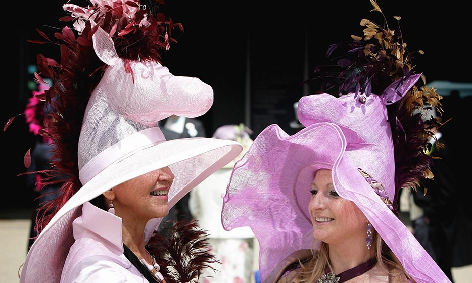 Staying true to the event's raison d'être, a pair of equestrian enthusiasts wore chapeaus in the shape of pink horses. <p>Photo: © Chris Jackson/Getty Images