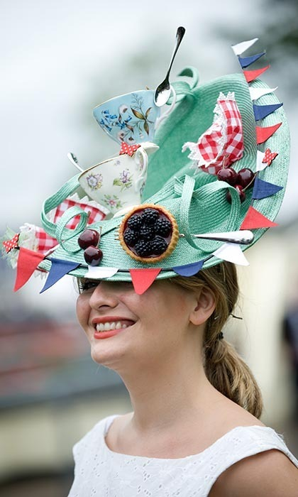 One racegoer was keen to flaunt her British pride with a tea party-inspired hat complete with blackberry tarts and teacups. Photo: © Samir Hussein/WireImage
