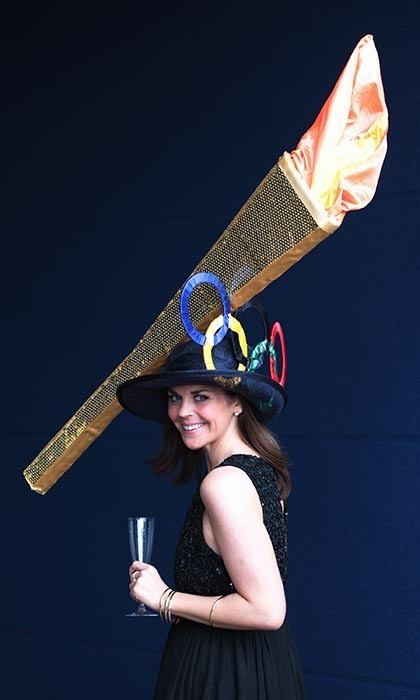 Racegoer <strong>Laura Nelson</strong> carried the likeness of the Olympic torch on her crown as a tribute to the international games. 