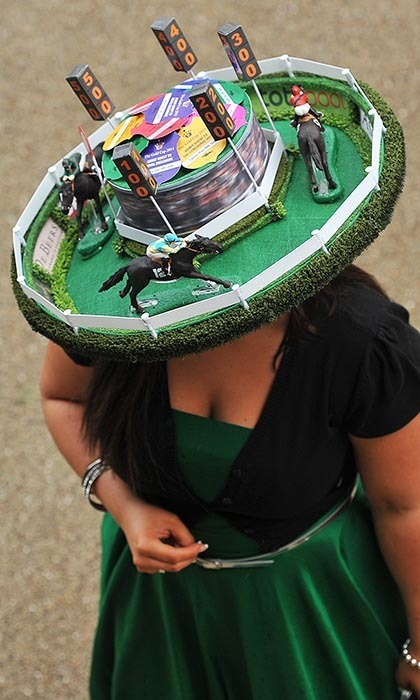 This creative lady took the racing theme quite literally, donning a miniature sculpture of a race track on her wide-brimmed hat. 