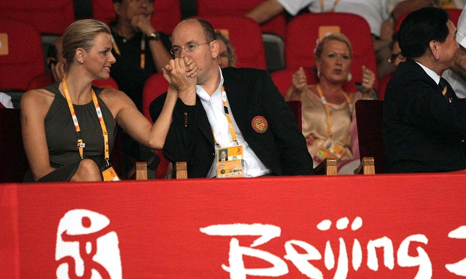 Just friends at the time, Prince Albert began to woo Charlene at the 2008 Olympic Games in Beijing as they watched a bout of boxing.