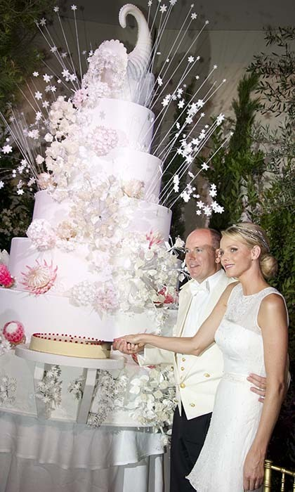 No wedding would be truly complete without the cutting of an enormous, seven-tiered cake!