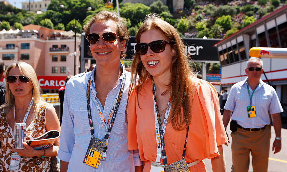 The happy couple smiled at onlookers at Monaco's Formula One Grand Prix in 2011. (Photo by Mark Thompson/Getty Images)