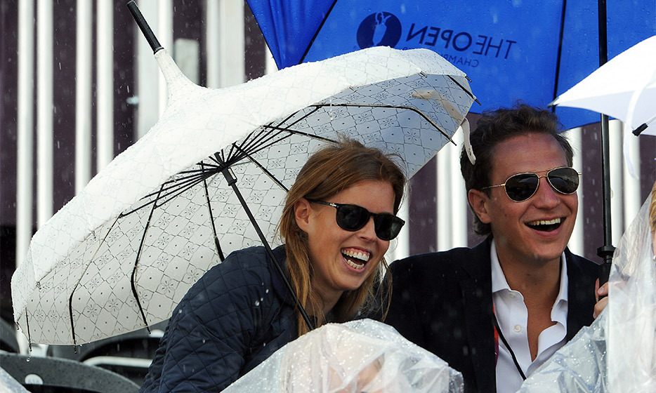 Not even a little rain could dampen their spirits, as Princess Beatrice of York and Dave Clark enjoyed a day at the Equestrian races during the 2012 Olympic Games in London. (Photo by Pascal Le Segretain/Getty Images)