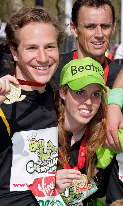 The couple that runs together stays together! The sporty pair showed off their medals after competing in the 'Caterpiller Run' as part of the London Marathon in 2010.  (Photo by Indigo/Getty Images)