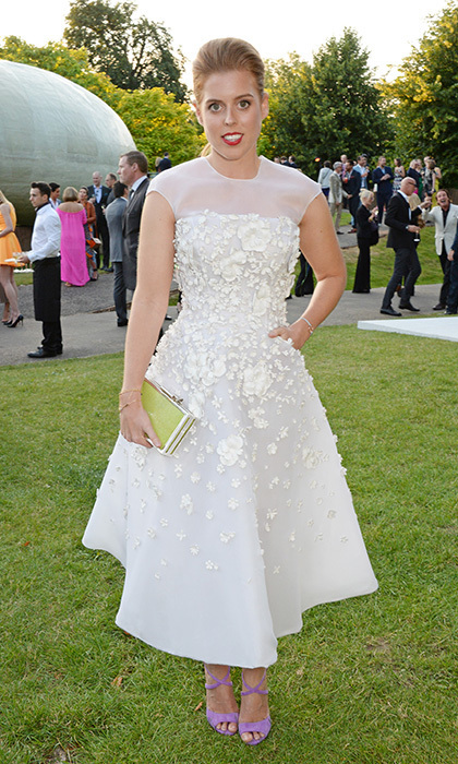 Beatrice didn't disappoint at 2015's Serpentine Gallery party in a white organza dress that was decorated with little flowers. She wore her flame-coloured hair swept back and injected a pop of colour with bright red lipstick. <br>Photo: © David M. Benett/Getty Images for The Serpentine