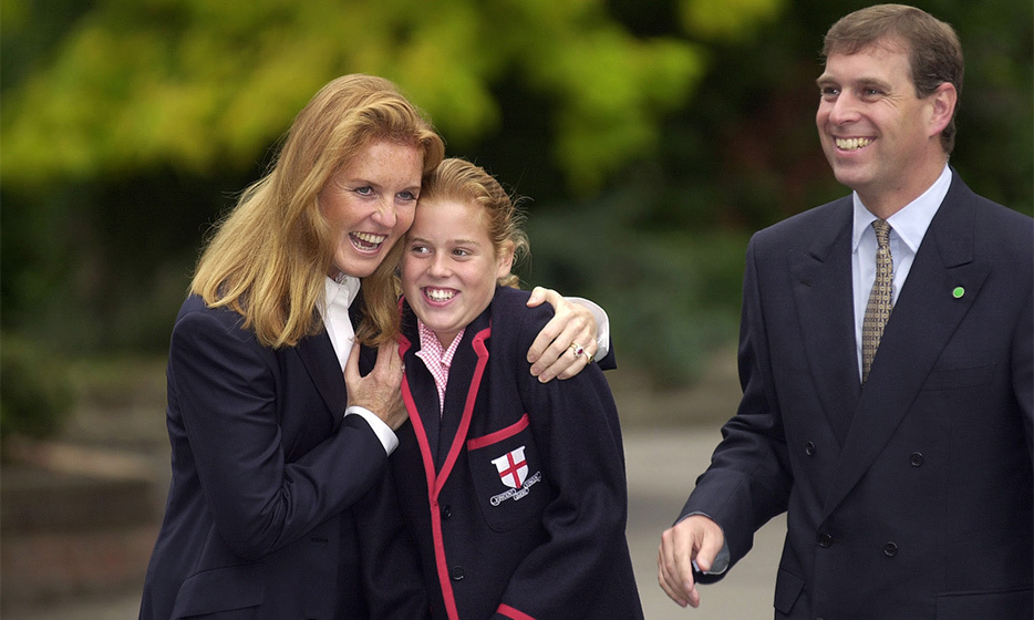 Giving their daughter a reassuring hug, Prince Andrew and the Duchess Of York couldn't have been more proud of Beatrice on her first day at St. George's school in 2000. <br>Photo: © Tim Graham/Getty Images