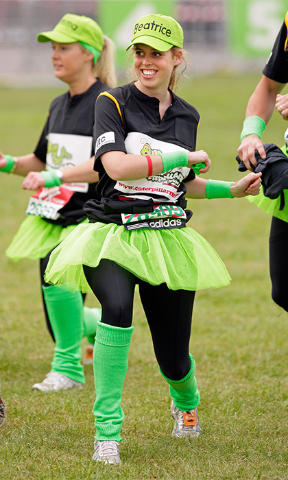 The fun-loving Princess wore a green tutu and a 'Beatrice' baseball cap for the London Marathon's 'Caterpillar' run, in which 32 runners were tethered together for a race.
