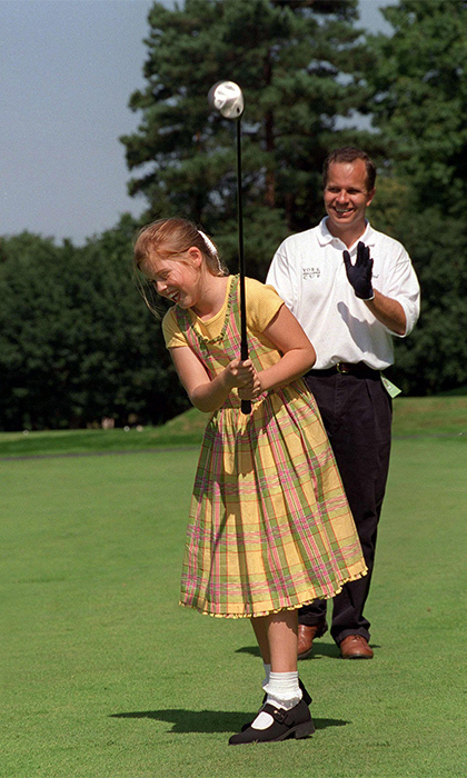 At a golf charity tournament, the Princess played a few rounds wearing a prairie girl-inspired ensemble — a plaid dress paired with black Mary Janes and frilly, white ankle socks.  
