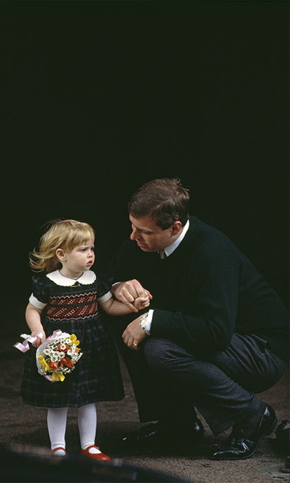 In a plaid-green dress and red Mary Janes, the little Princess was cute as a button standing next to her daddy, Prince Andrew. 