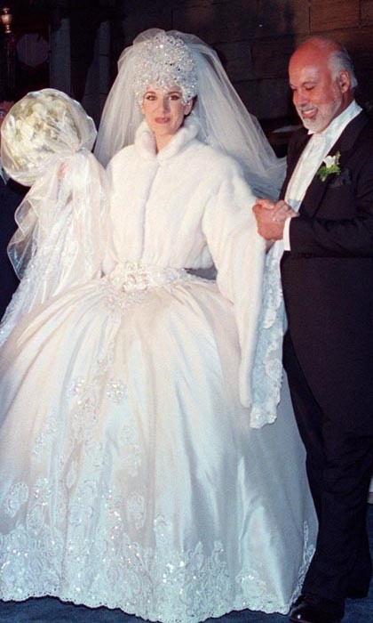 Celine and René were wed on Saturday, Dec. 17, 1994 in an extravagant Montreal ceremony, which was broadcast live on Canadian television. The kooky star wore a silk creation by Mirella and Steve Gentile – complete with a 20-foot train – and an enormous, Swarovski-crystal tiara that had to be sewn onto her head! (Photo: © CP)