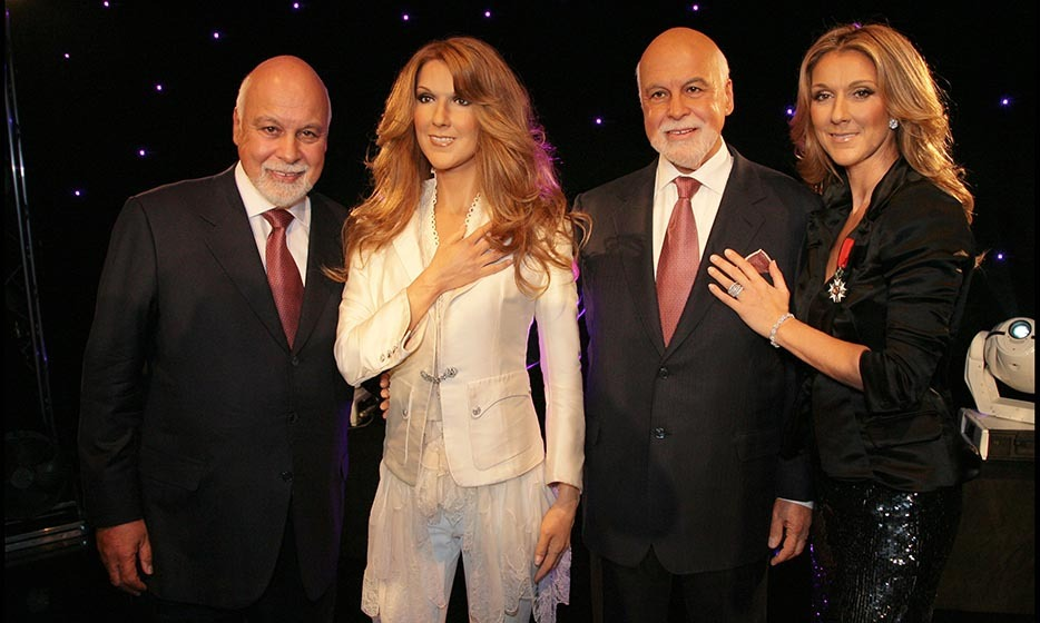 Celine and René enjoyed a moment with their wax replicas during the unveiling of the René Angelil wax statue at Museum Grevin in Paris in 2008. (Photo © Getty Images)