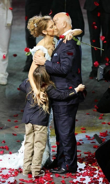 Dec. 15, 2007 proved to be an emotional day for Celine. The singer, who had just finished her last performance of 'A New Day…' at Caesars Palace, was embraced by her husband and son as fans threw roses at the stage. Almost three million people had watched her perform 717 shows since the show first opened in 2003. (Photo © Getty Images)