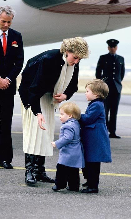 <p>Doting Princess Diana arrived at the airport with her sons in tow — she rarely travelled without them when they were young.</p>