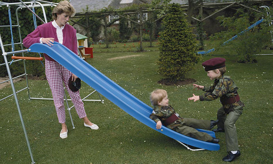 <p>Sporting matching military uniforms, William caught his little brother as he flew down a slide, while their mother watched adoringly.</p>