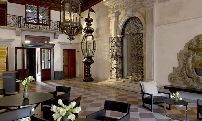 Murano chandeliers and silk wall hangings decorate the exquisite palazzo.