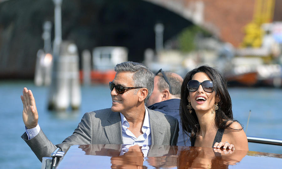 George Clooney and Amal Alamuddin radiate excitement at the start of a weekend of wedding celebrations. Photo: © Getty Images