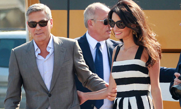 Amal Alamuddin showed off her style credentials in a mid-length Dolce & Gabbana number, which quickly sold out. Photo: © Rex