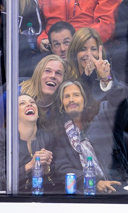 When Aerosmith crooner Steven Tyler attends a hockey game, he gets into it. The singer was on hand for a 2014 Stanley Cup playoffs game between the Los Angeles Kings and San Jose Sharks at the Staples Centre, and his nose was constantly pressed up against the glass as he closely watched the game. (Image: Noel Vasquez/Getty Images)