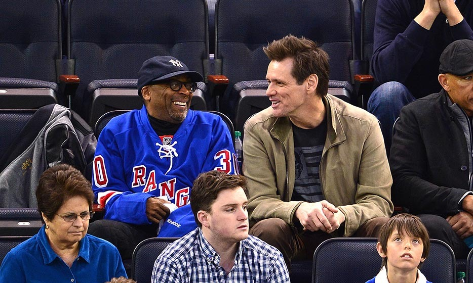 Spike Lee and Jim Carrey had the stands in stitches when they checked out game five of the 2014 Stanley Cup playoffs between the New York Rangers and the Philadelphia Flyers. Jim put his arm through one of Spike's jersey sleeves during the game and the two performed an impromptu comedy bit. (Image: James Devaney/Getty Images)