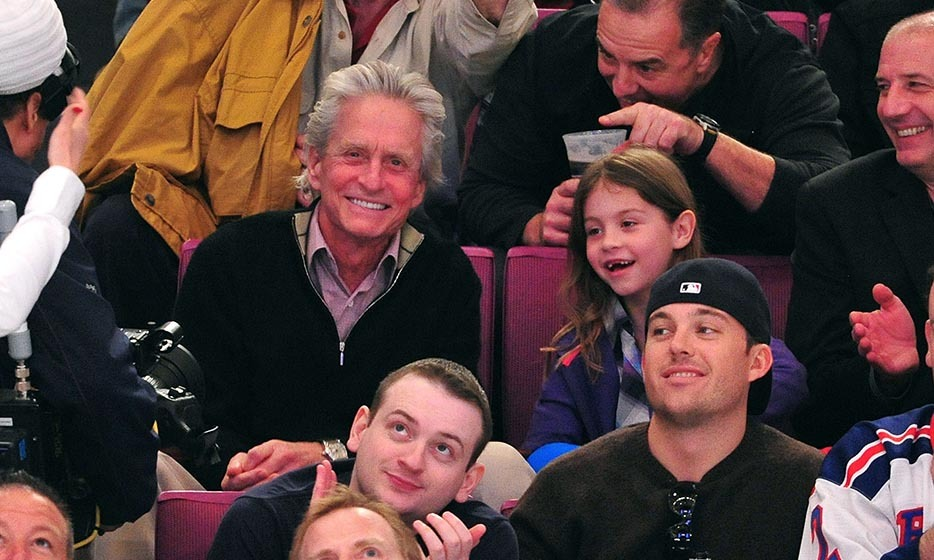 In 2011, Michael Douglas took his daughter, Carys, to watch the New York Rangers compete against the Washington Capitals in game three of the Eastern Conference quarterfinals at Madison Square Garden. (Image: James Devaney/Getty Images)
