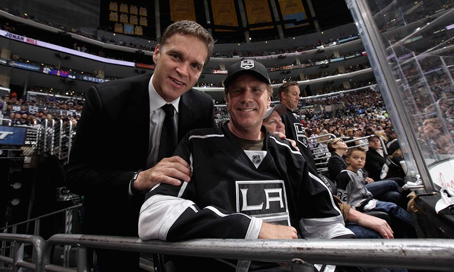 Ex-hockey-pro and Los Angeles Kings president of business operations, Luc Robitaille, chatted with Will Ferrell before game four of the Western Conference finals between the Kings and the Chicago Blackhawks in 2014. (Image: David Sandford/Getty Images)