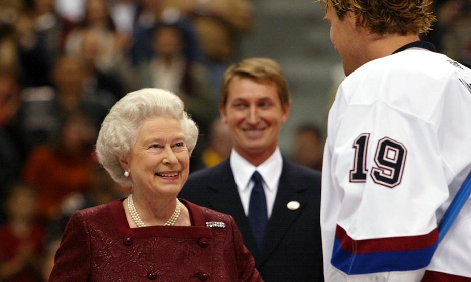 During Queen Elizabeth's 'Diamond Jubilee' tour in 2002, the British monarch was honoured with the opportunity to drop the puck alongside Wayne Gretzky at a match between the Vancouver Canucks and the San Jose Sharks. (Image: Kim Stallknecht/Getty Images)