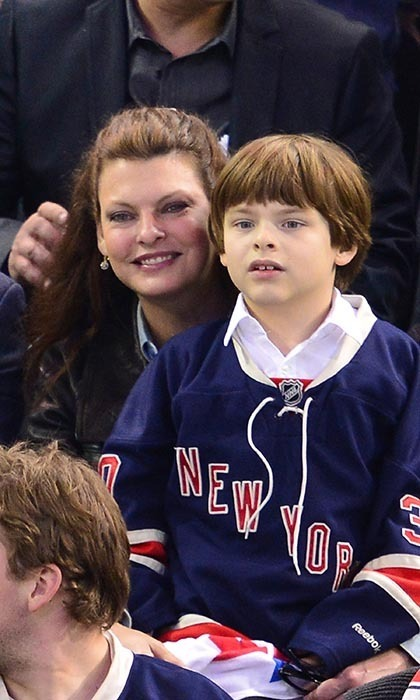 Canadian supermodel Linda Evangelista got the best of both her worlds at a match between Canada and the United States at Madison Square Garden in 2014. Linda watched the Montreal Canadiens face off against the New York Rangers in a playoff game with her son, Augustin James Evangelista. (Image: James Devaney/Getty Images)