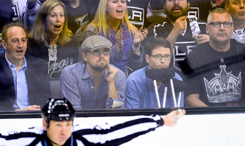 Celebrities love the playoff season, especially when they're seated against the glass! Leonardo DiCaprio joined Kevin Connolly in 2014 at an NHL playoff game between the San Jose Sharks and the Los Angeles Kings. (Image: Noel Vasquez/Getty Images)