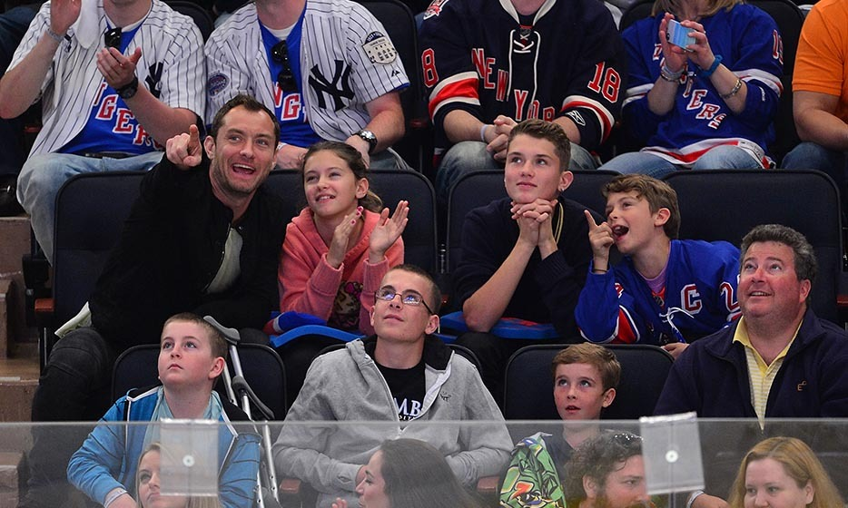 Jude Law had a father-daughter night out in 2012, taking his daughter, Iris, to watch the New York Rangers take on the Ottawa Senators at Madison Square Garden. (Image: James Devaney/Getty Images)