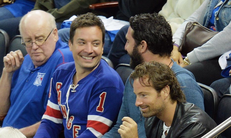 Jimmy Fallon was in a New York state of mind in 2014 when he hit game three of the Stanley Cup finals with New York Mets player Matt Harvey. The duo rooted for the New York Rangers as they faced the Los Angeles Kings. (Image: Mike Coppola/Getty Images)
