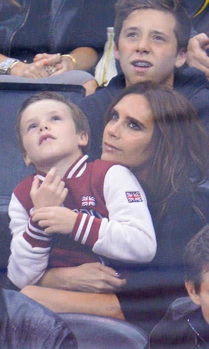 Victoria Beckham is married to a soccer all-star, so she knows a thing or two about team sports. The Beckham brood routinely descends on Los Angeles Kings games, seen here at an L.A. versus San Jose game in 2013. (Image: Noel Vasquez/Getty Images)
