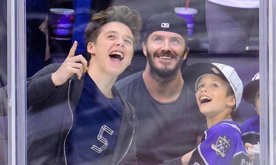 Back in May of 2014, David Beckham took his sons Cruz, Romeo and Brooklyn to a Los Angeles Kings game for a good old-fashioned boys' night out. (Image: Noel Vasquez/Getty Images)