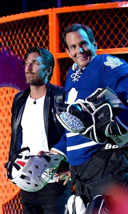NHL player Henrik Lundqvist and comedian Will Arnett teamed up to present at the 2014 Nickelodeon Kids' Choice Sports Awards. The actor used the opportunity to show off his hometown pride, wearing goalie padding and a Toronto Maple Leafs jersey. (Image: Kevin Mazur/Getty Images)