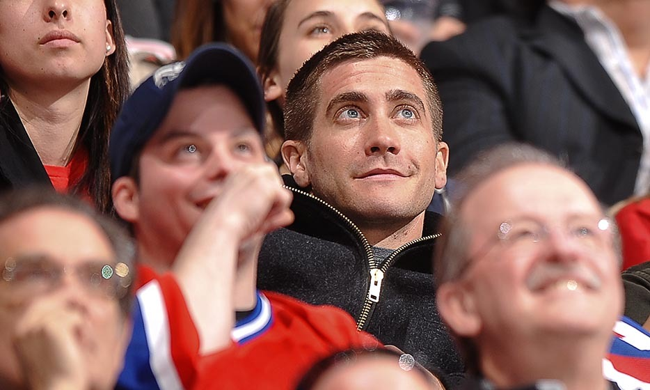 In 2010, Jake Gyllenhaal was in Montreal shooting 'Source Code' with Michelle Monaghan and Vera Farmiga. On a break from filming, Jake took to an NHL game between the Washington Capitals and the Montreal Canadiens. (Image: Francois Lacasse/Getty Images)