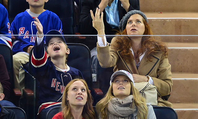 Like mother like son! Clearly the apple doesn't fall far from the tree for Debra Messing and her son, Roman Walker Zelman, both gesturing emphatically during the New York Rangers vs. Toronto Maple Leafs game on Oct. 12. (Photo: James Devaney/GC Images)