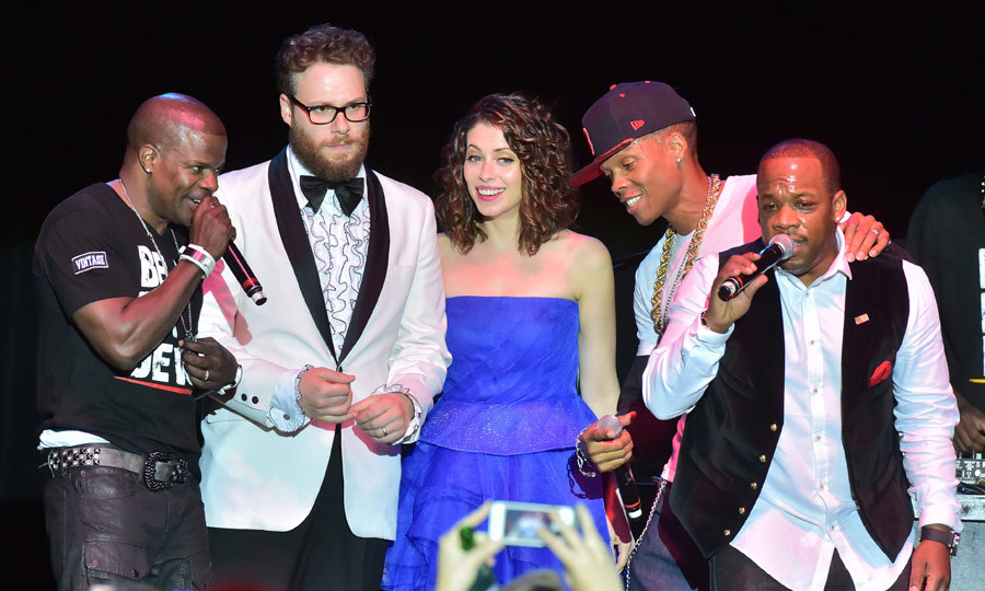 Seth and Lauren Miller Rogen joined Bell Biv DeVoe on stage during the '90s R&B trio's performance at Hilarity for Charity. (Image: Getty)
