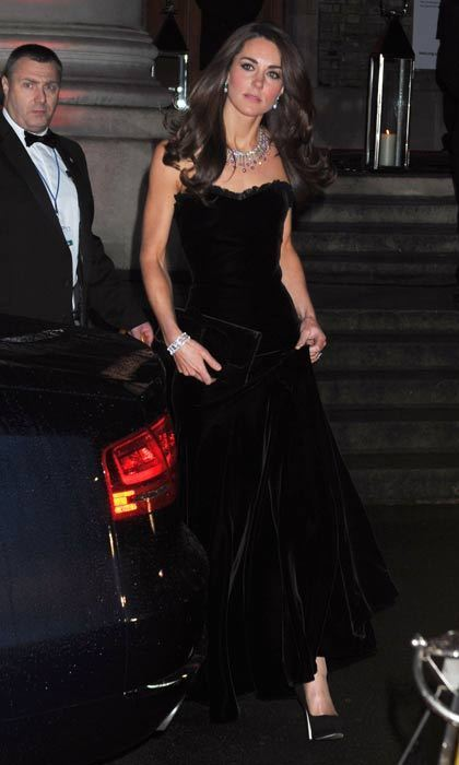 Sporting a sumptuous black velvet Alexander McQueen gown at an awards ceremony at the Impreial War Museum in December 2011.