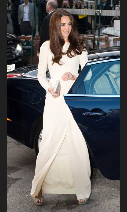 Mastering the art of evening dressing in a stunning white Roland Mouret dress at a dinner at Claridges in May, 2012.